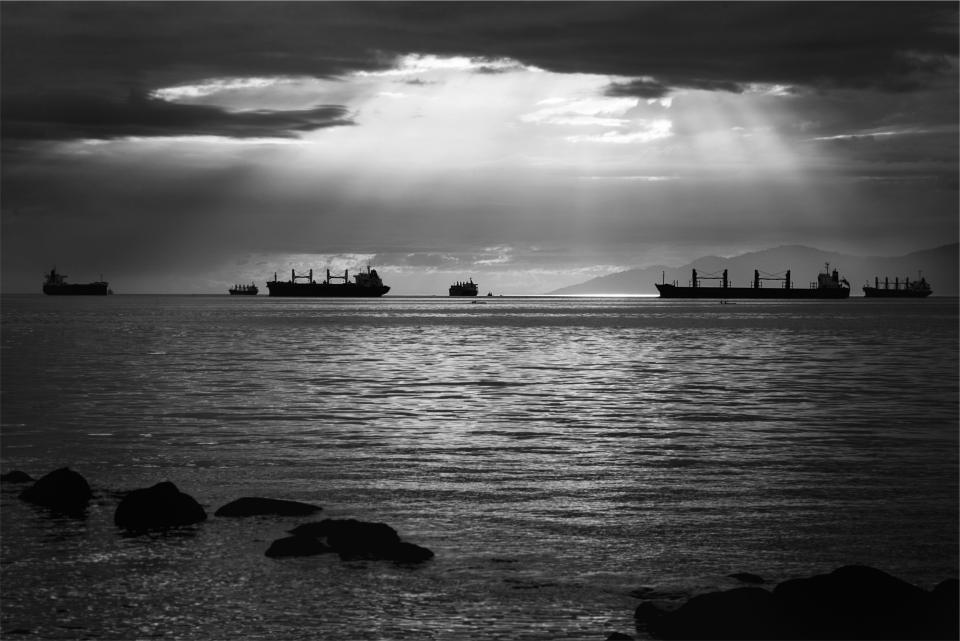 sunbeams boats ships ocean sea water clouds black and white