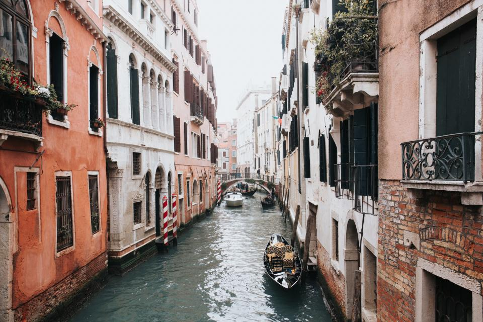 architecture buildings city canals waterways boat water ripples brown venice italy europe