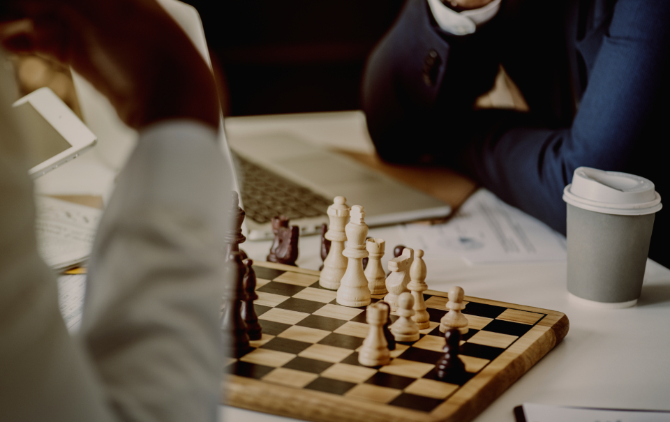 business business people business strategy challenge chess closeup competition decision diversity formal game hands help mind game mind games people performance planning playing solution strategy strength success tactic target