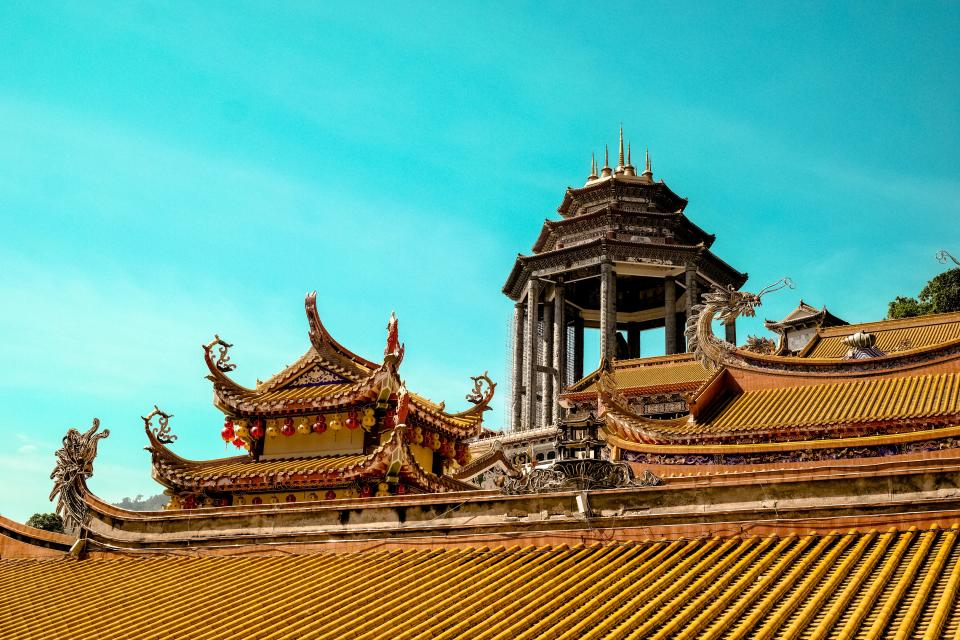 architecture buildings chinese temple patterns roof shingles dragons sculptures foreign yellow blue