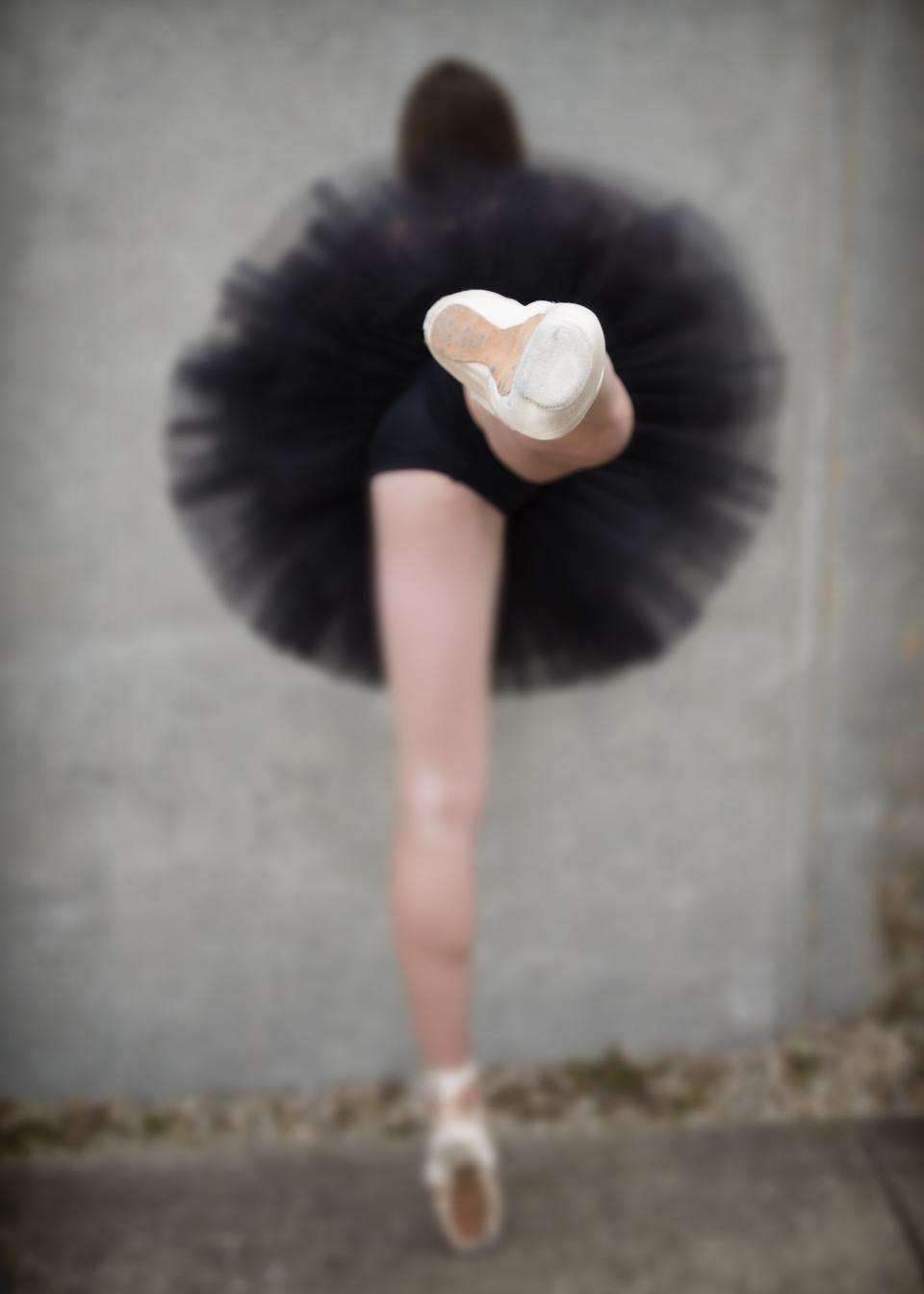 woman girl lady people dance lift leg tutu still bokeh