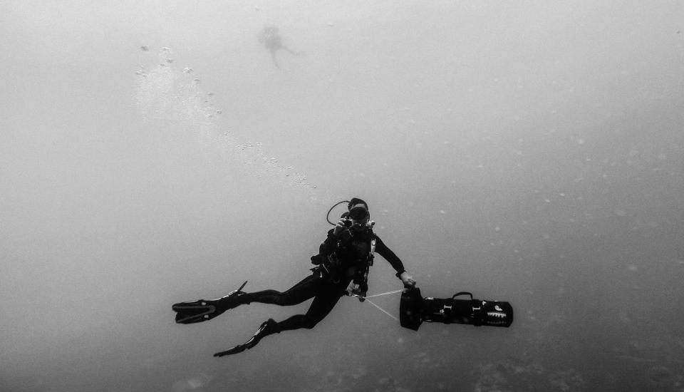sea ocean water nature people man swimming scuba diving oxygen underwater black and white