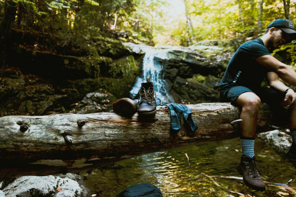 nature woods forest creek stream water boots socks people man guy traveler hike millennials