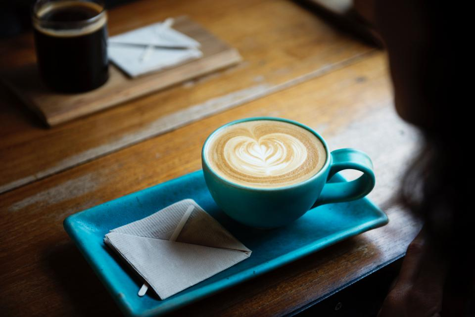 coffee hot drink espresso cup saucer spoon cafe latte art wood table