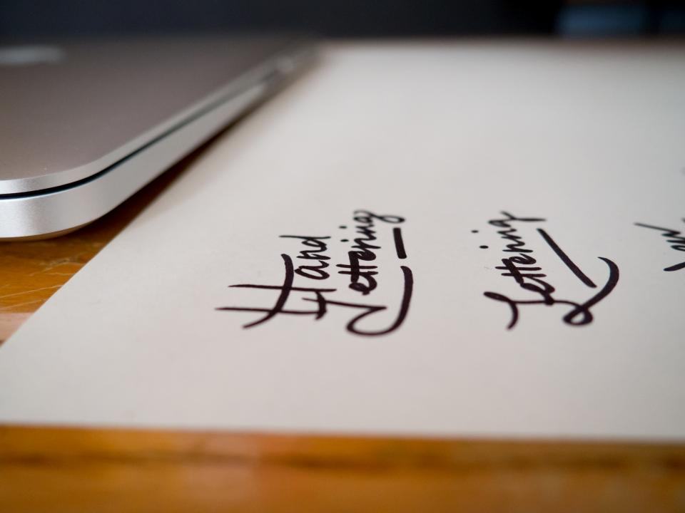 office work business worskpace table desk gadgets technology computer macbook laptop lettering handwriting typography calligraphy paper ink bokeh still