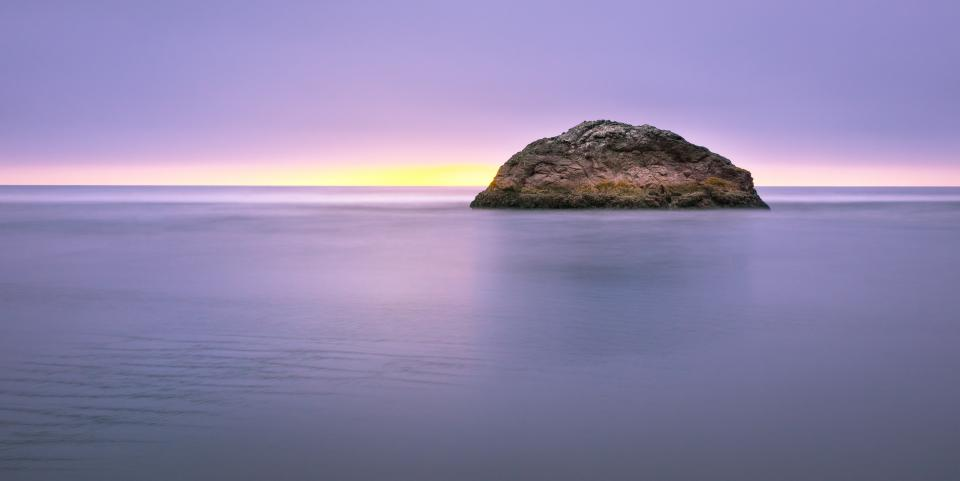 rock sea water ocean nature beach shore sand sky purple sunset horizon