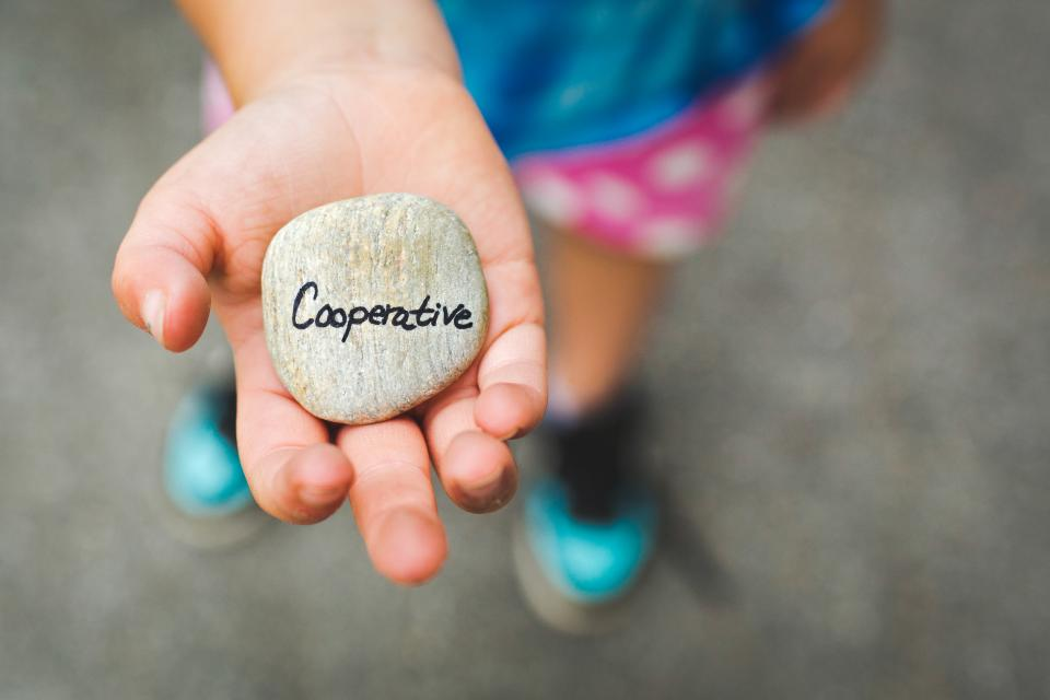 typography rock stone hand palm kid child blur