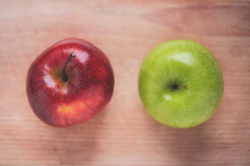 food fruits apples row red green wood table top view shine sheen still bokeh