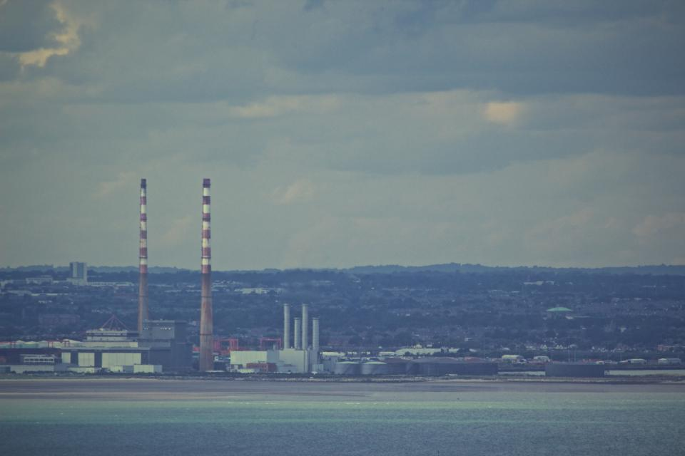 industrial factories chimneys view water coast Dublin city view sky