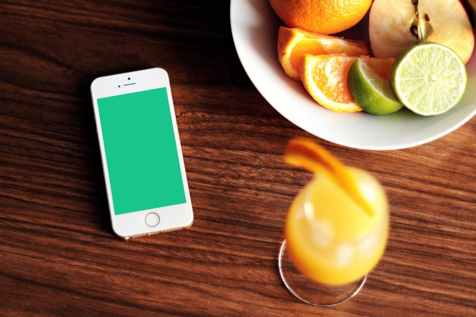 iphone mockup cell phone mobile apple technology orange juice glass mimosa fruits limes apples bowl table