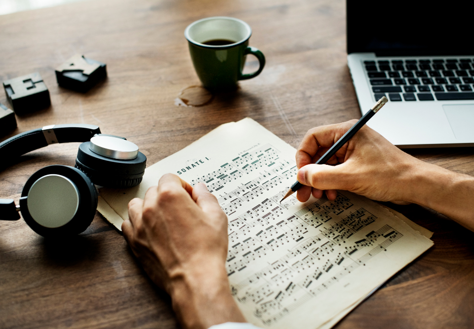 writing sheet music aerial background cafe coffee communication compose composer computer connection cup daily device digital dream earphones entertainment hand headphones hobby home internet keyboard laptop lifestyle medi