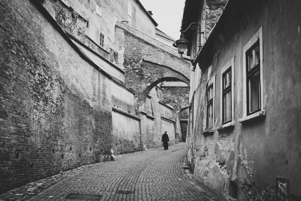 cobblestone street road city bricks architecture vintage black and white