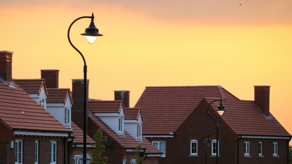 house wall bricks window village light bulb pole sky sunset sunrise orange