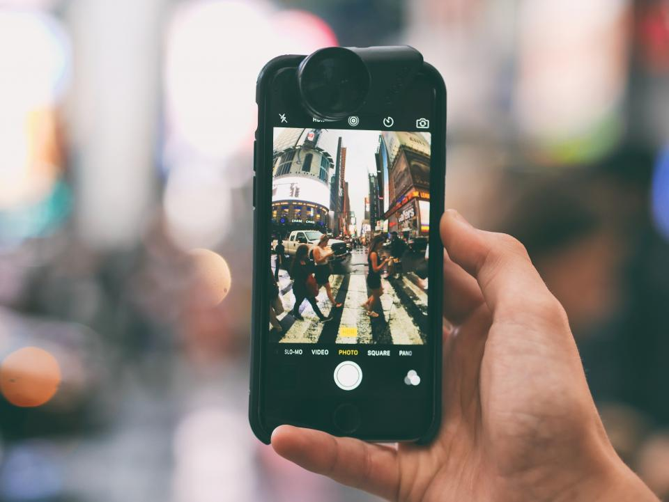 technology photography gadgets iphone smartphone mobile lens fisheye hand hold city pedestrian lane people still bokeh