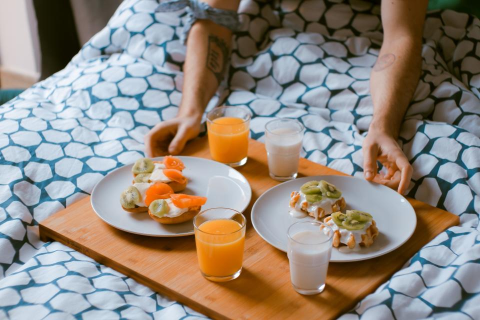 food breakfast in bed juice glass serve preparation people man hands couple love