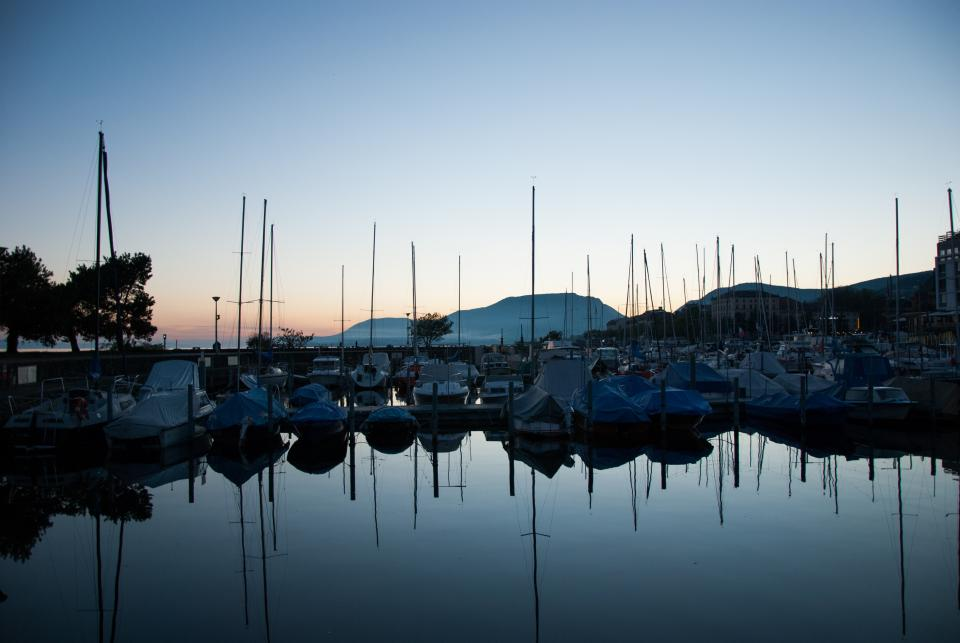 dock boats yachts nature water reflection lines linear sky clouds gradient blue