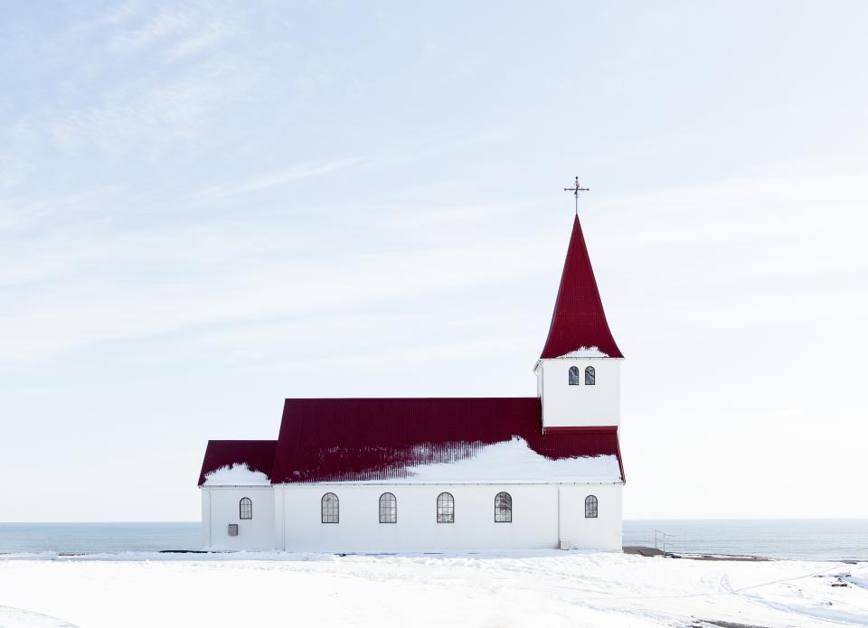 snow winter church building structure sea water clouds sky