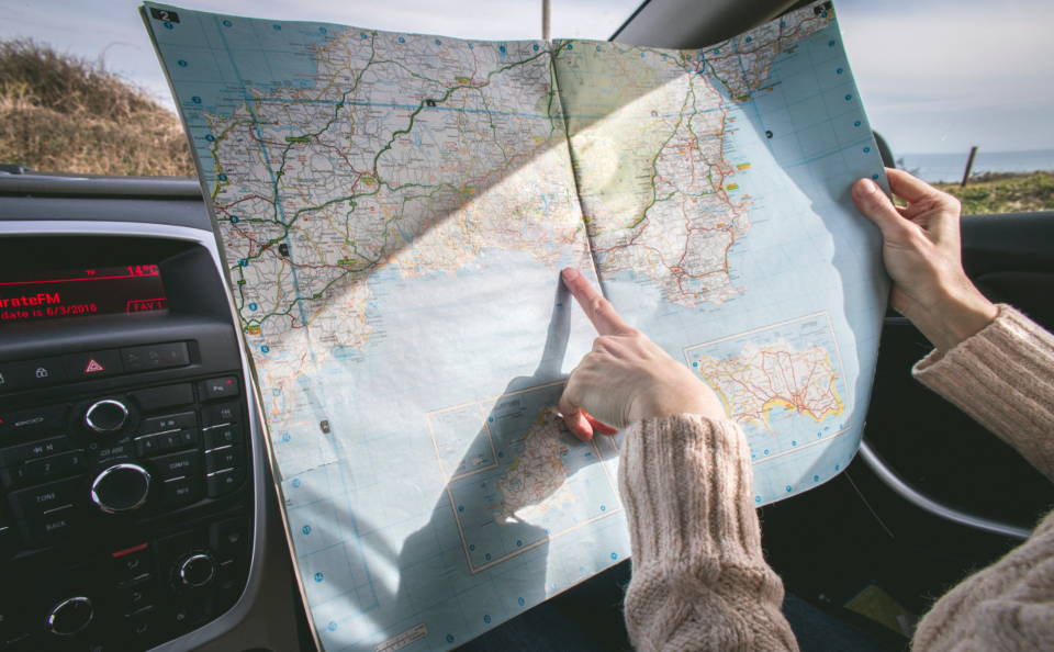 travel map car vacation direction compass destination finger woman female people