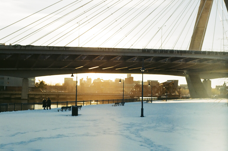 bridge city architecture structure modern cable lines design travel winter couple walking snow lights benches park daytime