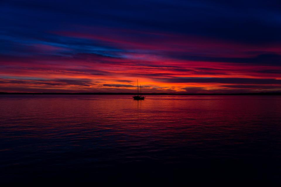 sunset dusk sky clouds boat ocean sea water horizon landscape nature outdoors night evening