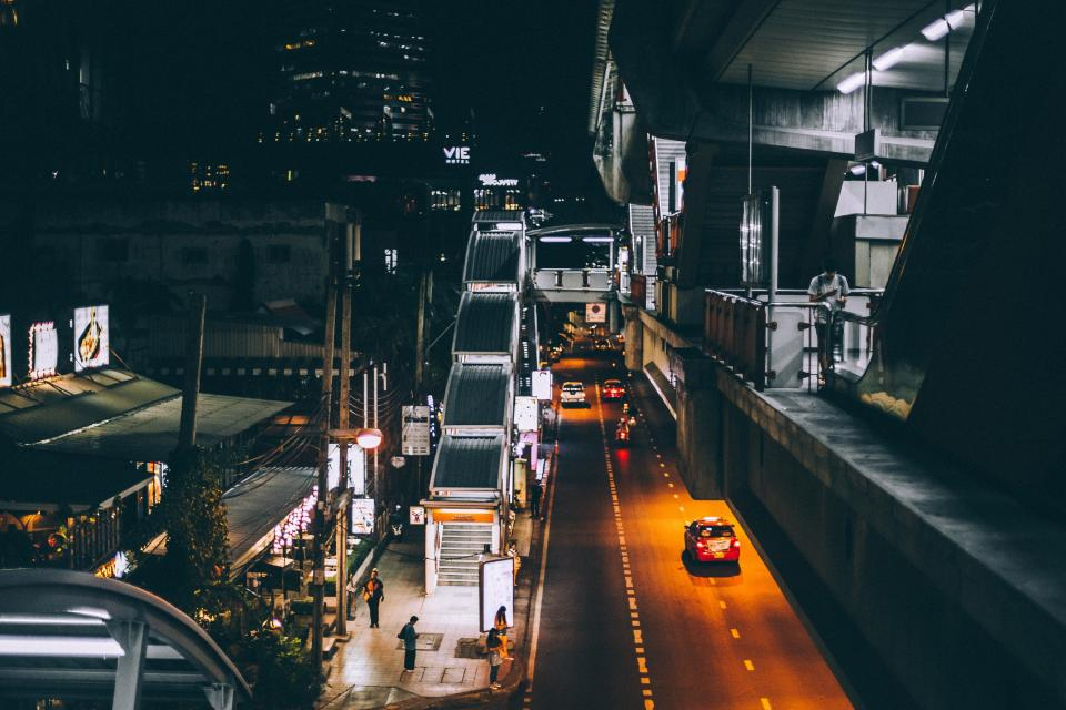 dark night urban city car vehicle transportation light building establishment infrastructure stairs overpass