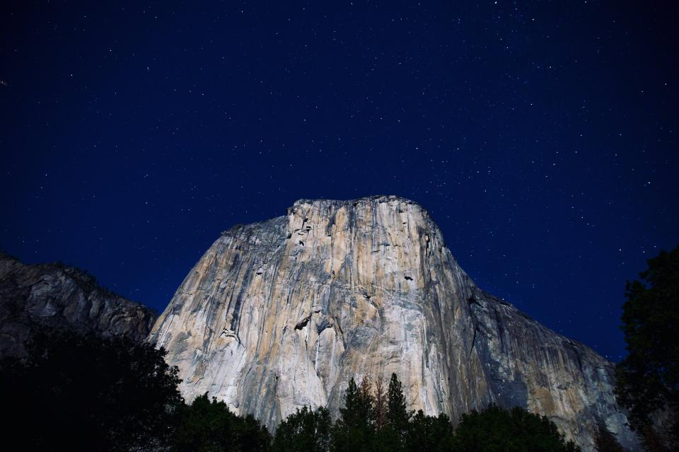 nature mountain cliff forests trees sky clouds stars constellations night