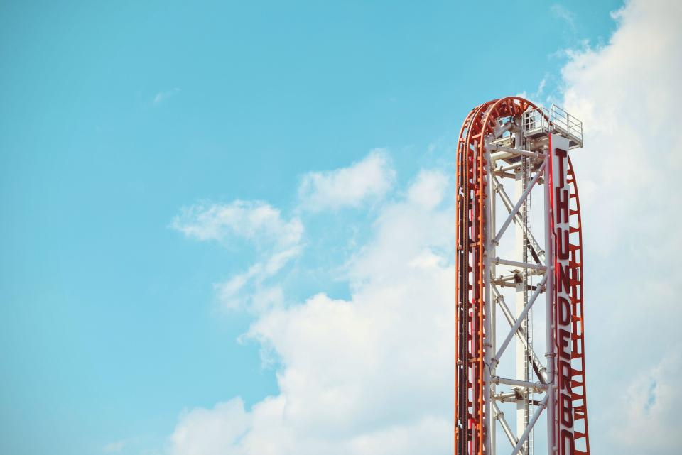 amusement park roller coaster fun ride summer sunshine blue sky clouds