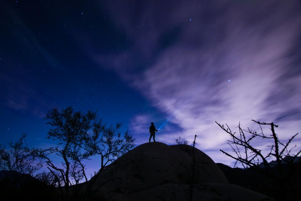 people man shadow alone travel adventure peak summit trees dark night clouds sky