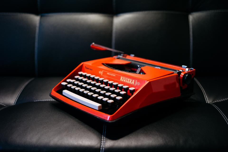 typewriter writing business work letters couch leather