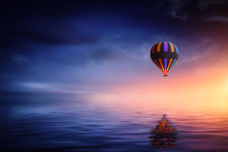 hot air balloon blue sky nature sea ocean reflection travel adventure transportation airship flying float