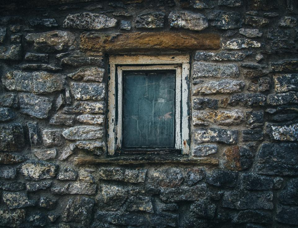 house home residential rocks stones walls old decrepit windows still charcoal