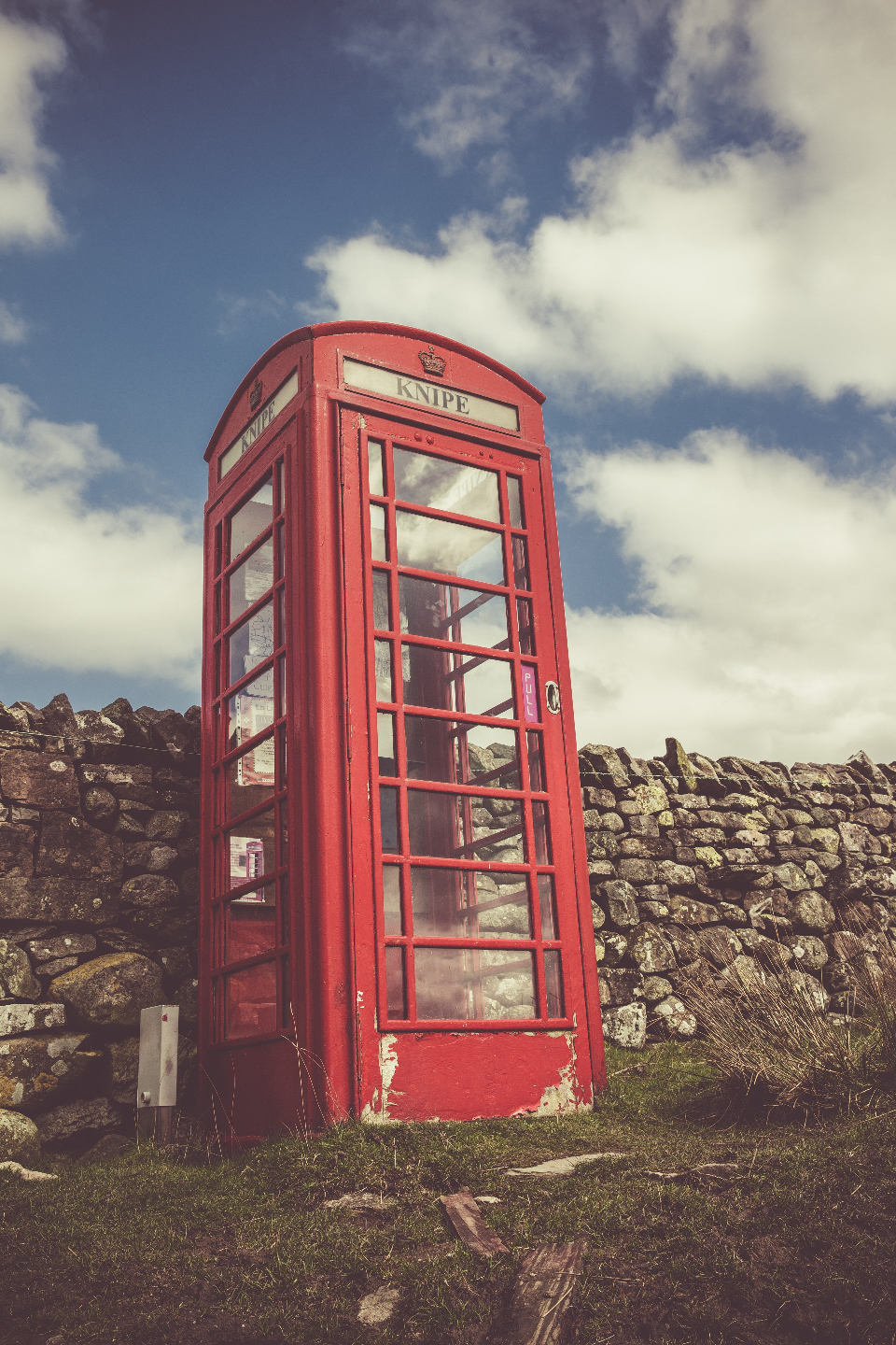 vintage red phoebox phone telephone england uk stone wall country clouds