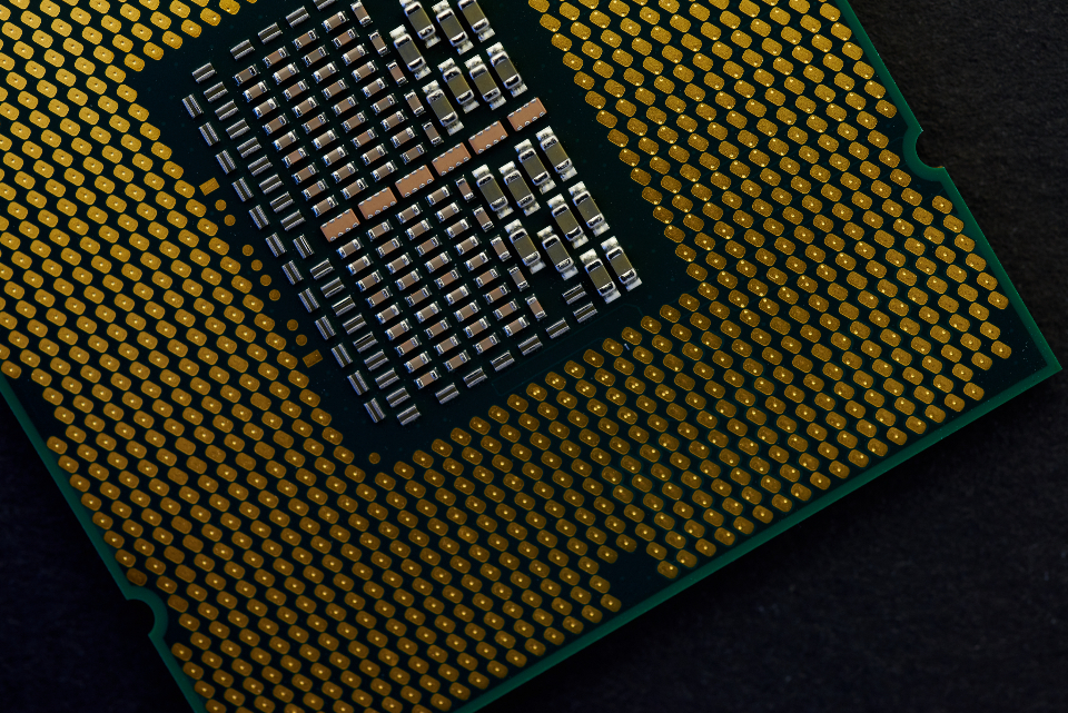 cpu processor chip computer macro close-up technology background circuit component dark focus selective hardware intel tech