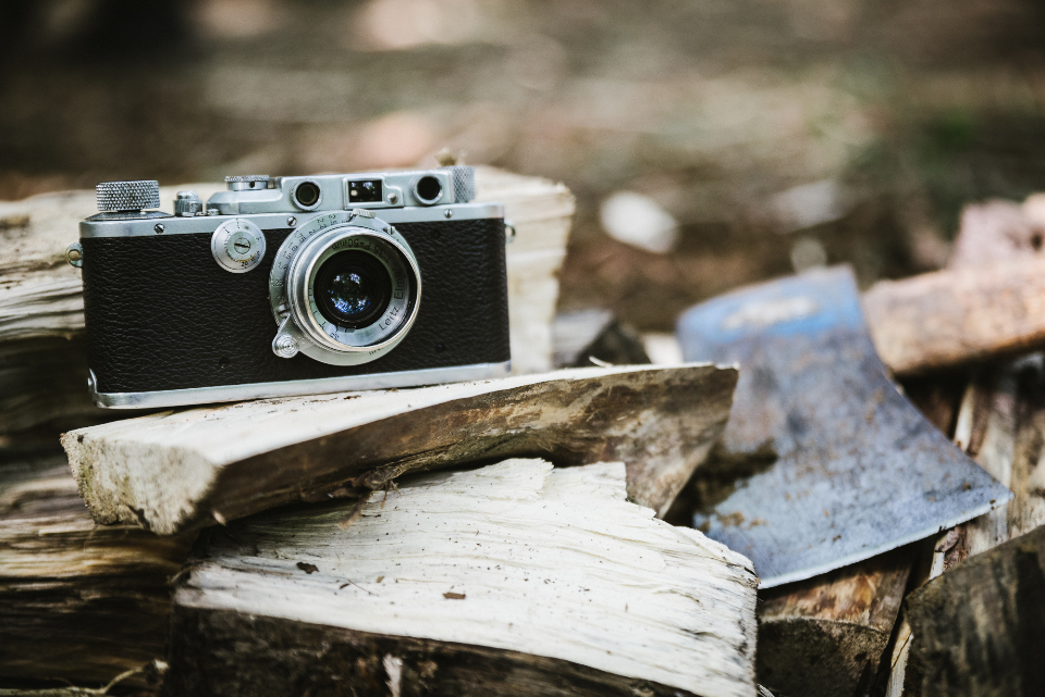 retro classic camera black lens wood chop axe fire firewood vintage technology phtographer photo