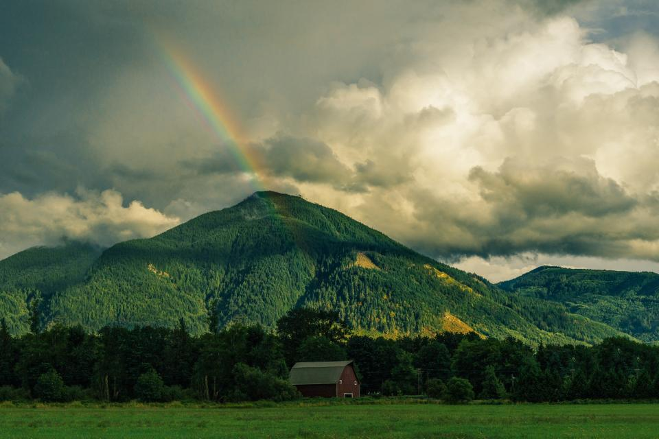 rainbow mountains hills green grass fields trees nature landscape sky clouds barn rural countryside