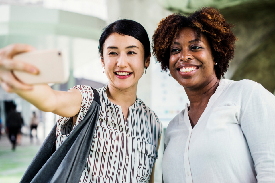 african american asian cheerful communication community connecting connection data device digital electronic ethnicity friends gadget global happiness information innovation internet media mob