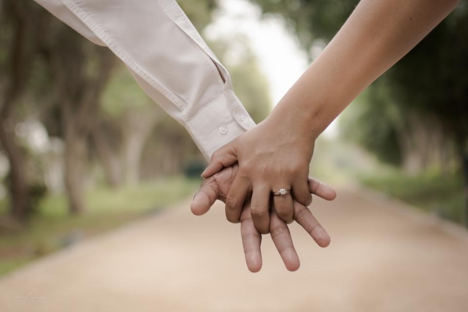 couple man woman girl guy bokeh trees love people holding hands ring road blur