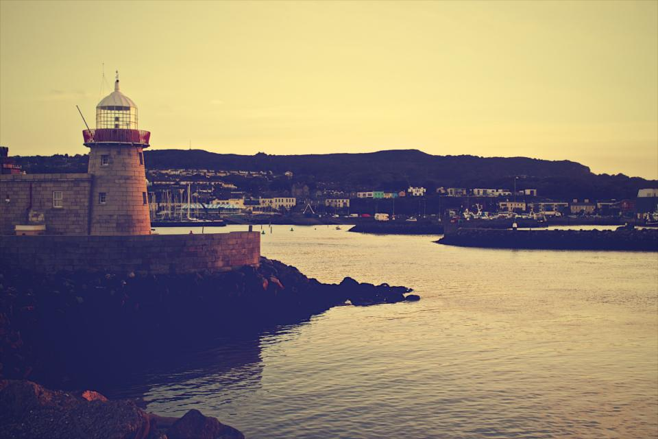 lighthouse coast water rocks boats marina docks harbor harbour mountains sunset dusk Howth Dublin Ireland