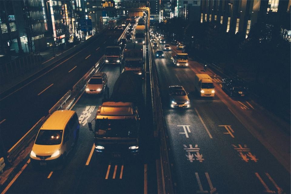 traffic cars trucks roads streets night dark evening Asia buildings city downtown architecture lights