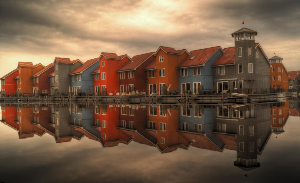 netherlands colorful houses water reflection sky architecture docks roofs