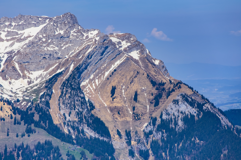 view mountain landmark Stanserhorn Pilatus summit peak Swiss Alps Alps alpine spring springtime slope tree spruce snow nature sky blue cloud white Switzerland Swiss Europe European