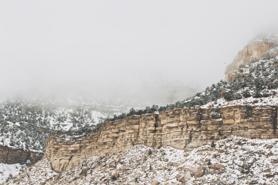 mountains cliffs rocks snow winter cold fog