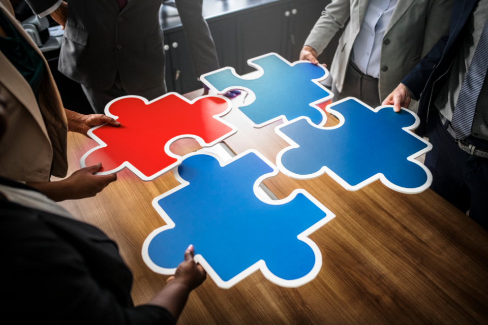 accomplished business people communication connected connecting cooperation discussion group happy holding inspiration jigsaw joining man meeting merging partnership people piece plan puzzle puzzle piece