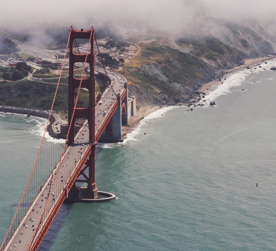 golden gate bridge infrastructure sea ocean water shore coast rocks mountain view landscape travel fog