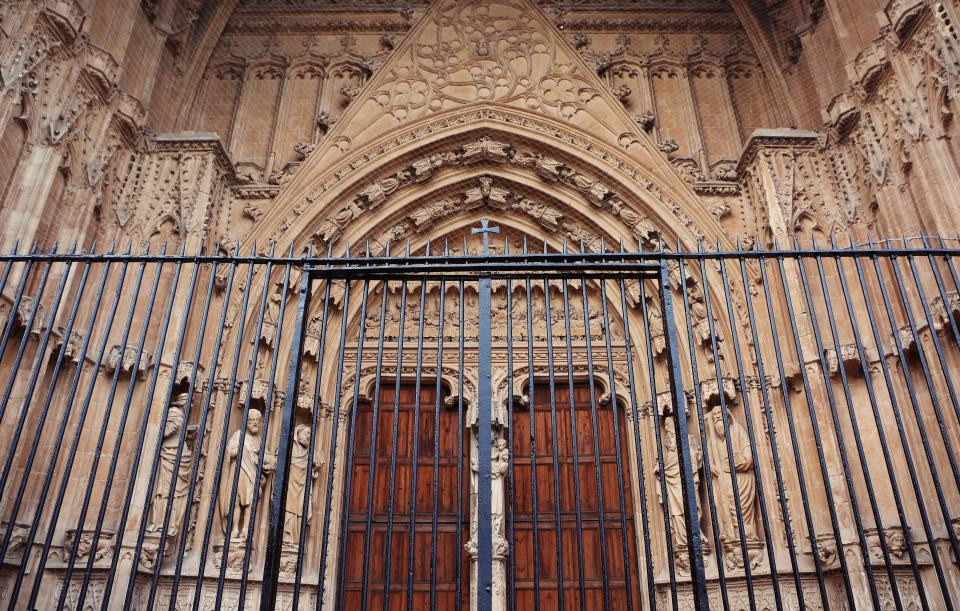 church religion cross architecture gate railing wood doors arches