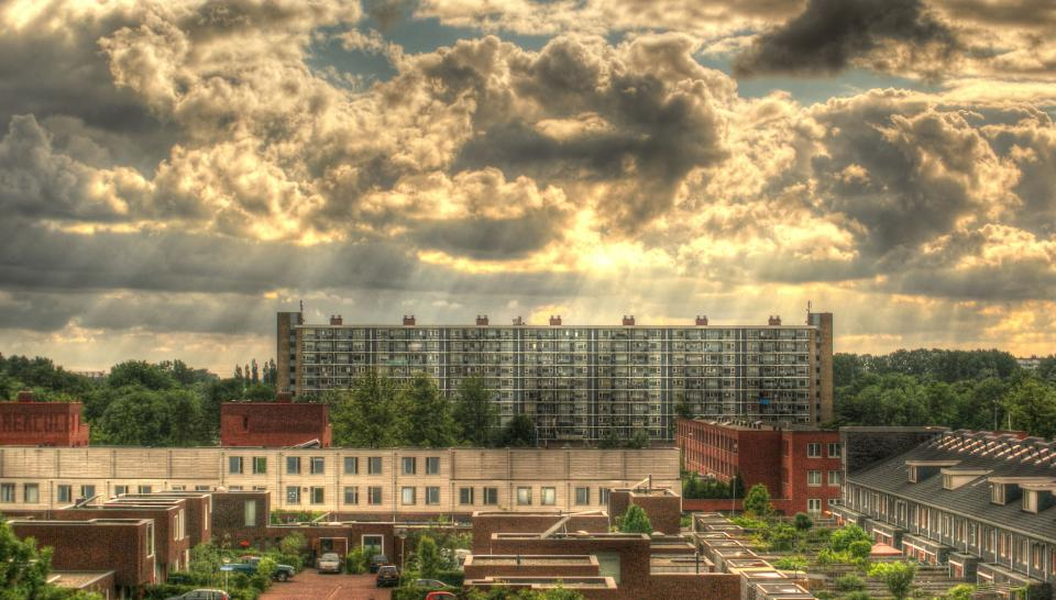 sunbeams sky clouds buildings houses apartments urban city hdr