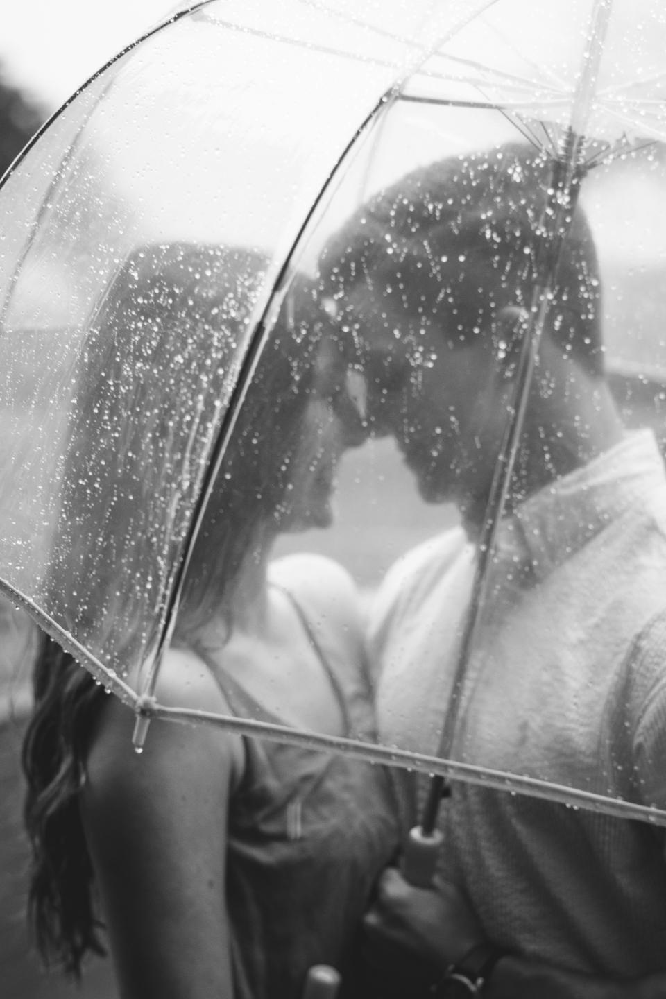 couple love romance girl guy umbrella raining wet black and white people