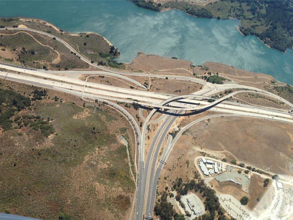 roads highways exits overpass water lake overhead view aerial