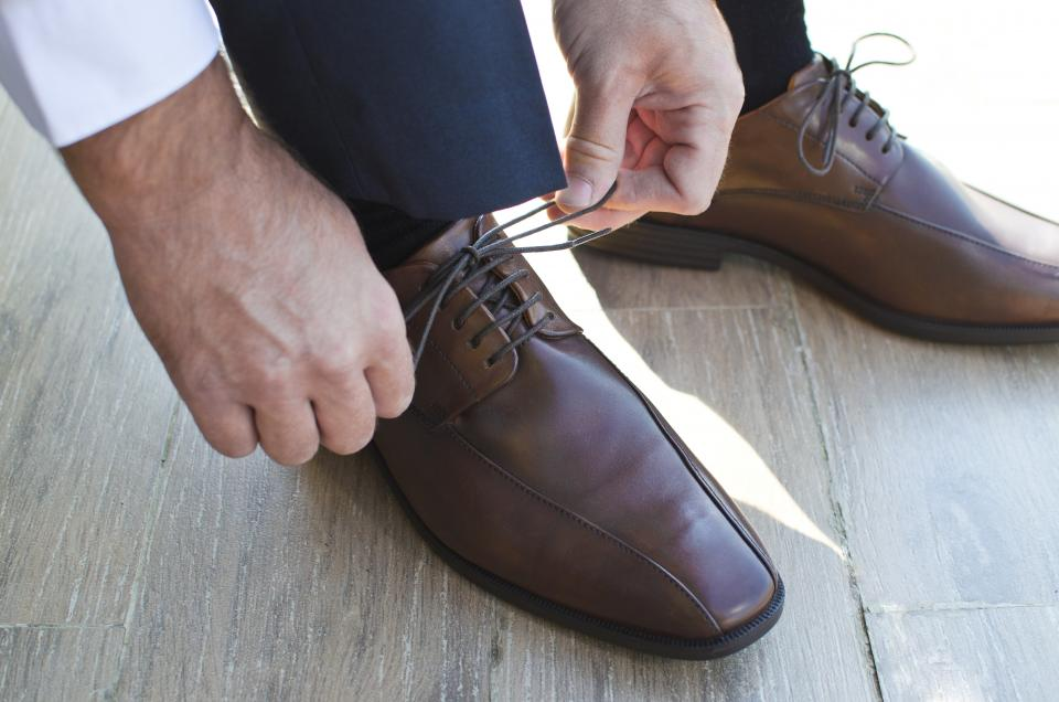shoes knot footwear wooden floor guy work business shadow hands fashion