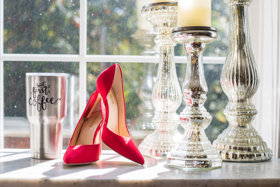 red heels shoes table fashion footwear female glamour woman design object stiletto classic window